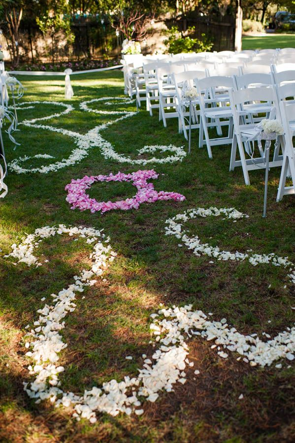 Flower petal pattern lining the wedding aisle (Julie Nicole Photography)