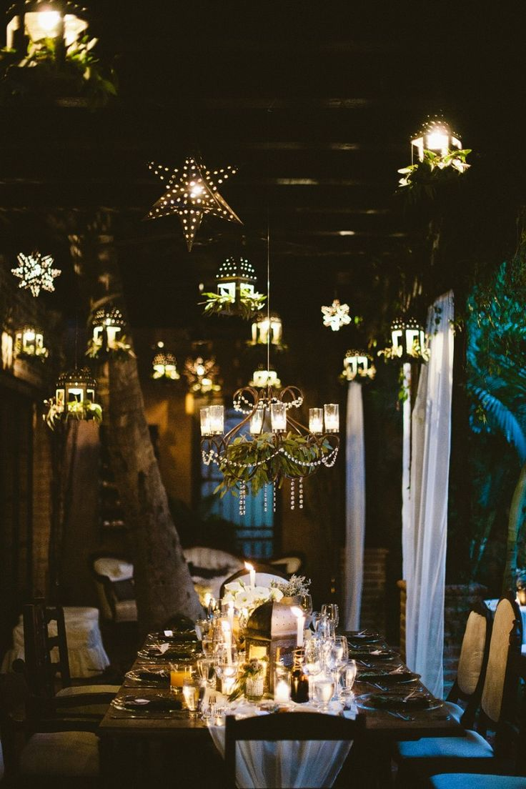 Rustic dinner table and lighting. Wedding coordination and design by www.thedazzlingdetails.com