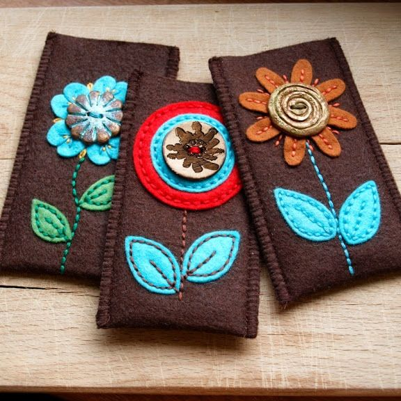 Flower appliquéd felt pouches - maybe glasses cases - pic for inspiration
