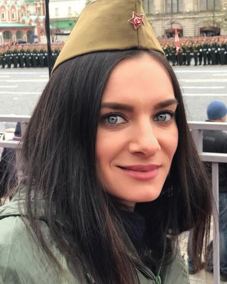Yelena Isinbayeva, now a captain in the Russian army, celebrating Victory day in the Red square. Still hot af