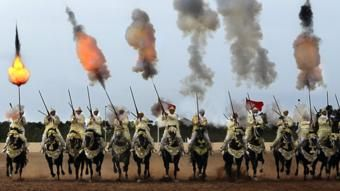 Traditional Moroccan knights fire in an equestrian show during the Festival of Tbourida, a competition between the Moroccan tribes, in Al-Jadidah, Morocco, 18 October 2017. Tbourida is a traditional exhibition of horsemanship in the Maghreb performed during cultural festivals and to close Maghrebi wedding celebrations. The performance consists of a group of horse riders, all wearing traditional clothes, who charge along a straight path at the same speed so as to form a line, the pickup speed…
