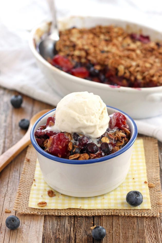 Blueberry Mango Crisp can be served warm with a scoop of vanilla ice cream. Perfection!