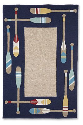 Cheerful, painted oars impart a distinctly nautical theme to this durable indoor/outdoor rug.
