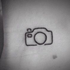 Afraid to get your first tattoo? Start small! This adorable little camera tattoo is perfect for the snap-happy photographer (Instagram pros definitely count).