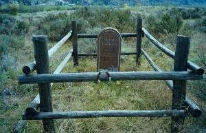 His grave is located about five hundred yards outside the cemetery on top of the hill to the south of the cemetery. The restless ghost of gun toting Frank Watkins is said to have haunted the Riverside Cemetery for the last ninety five years because the town folks wouldn't let him be buried in the cemetery.