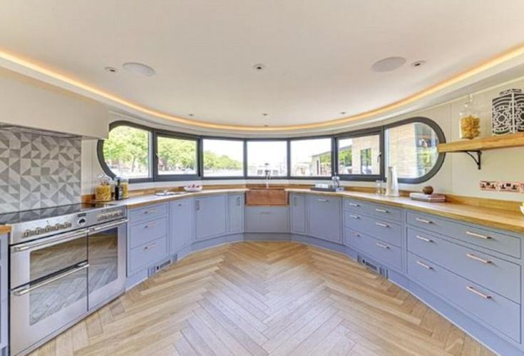 Cooking afloat: a fully-fitted kitchen on an updated Dutch barge is complete with contemporary appliances. It features an electric range oven and hob, dishwasher, two fridges and one freezer - Feb '18