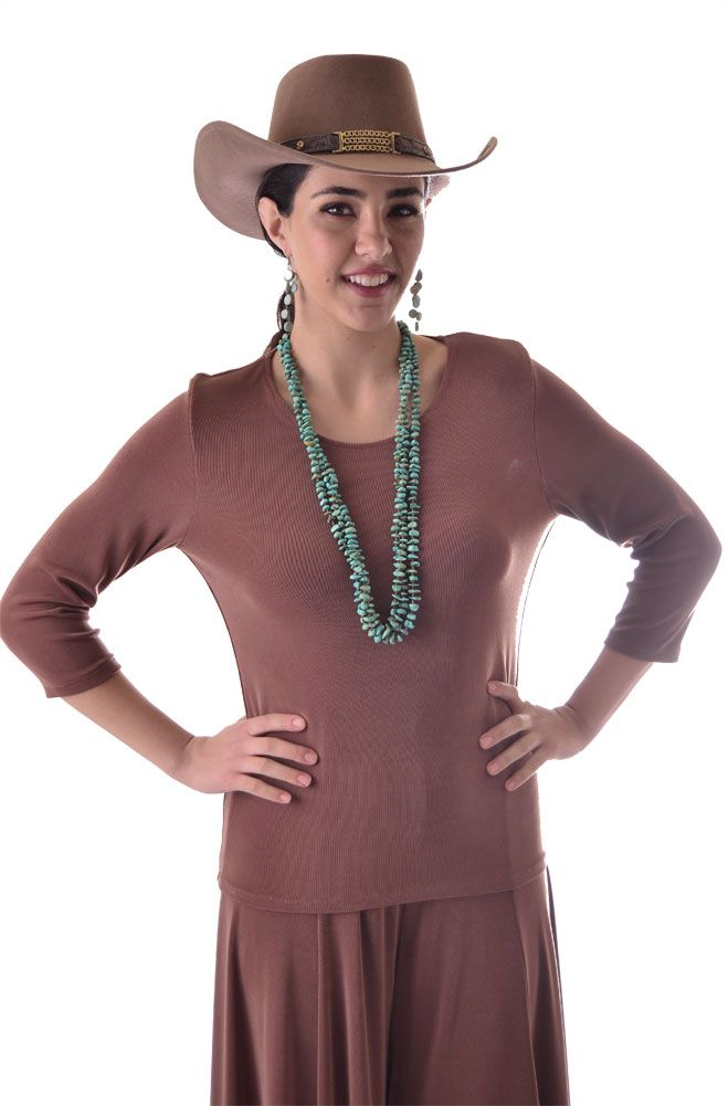 A new color Coco is introduced for our best seller top to wear with our matching Gauchos or Skirt. Thsi is a great color to have in your wardrobe to match your turquoise jewelery paired with one of our Western Shawls or Western Jackets and Vests or simply with any cowgirl outfits.It is simple yet classy enough to wear just about anywhere. In the photoabove we are showing it...
