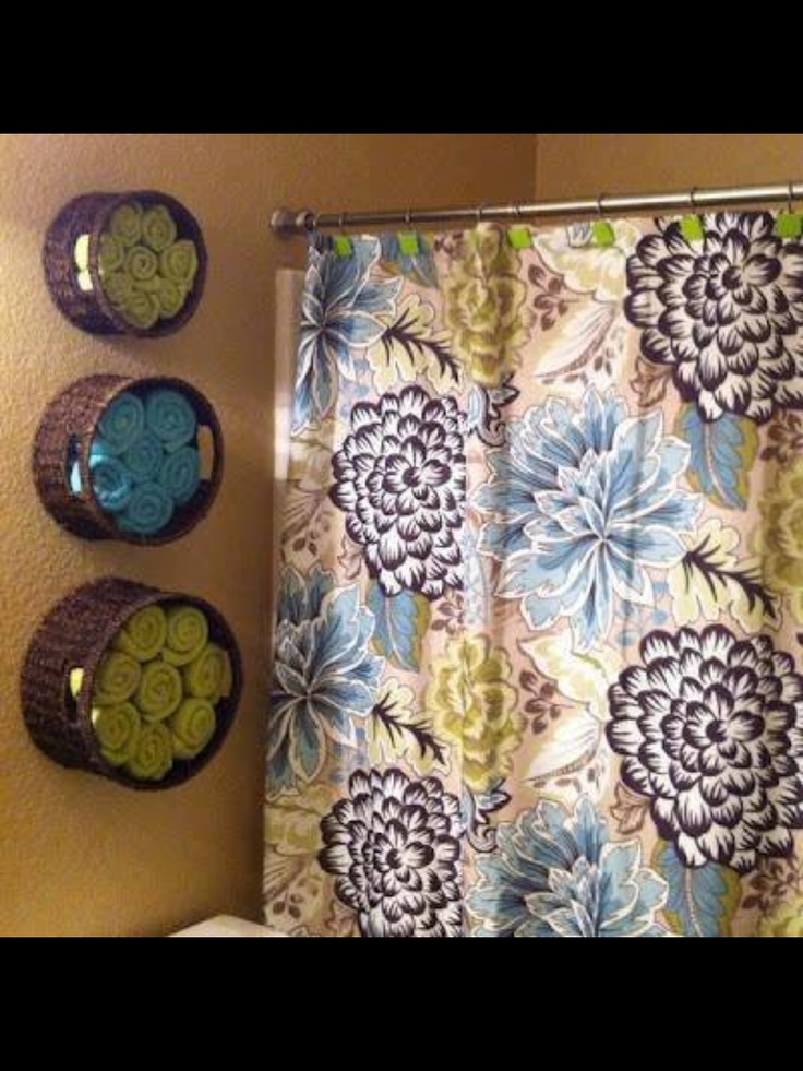 Baskets for towel storage and I luv the shower curtain