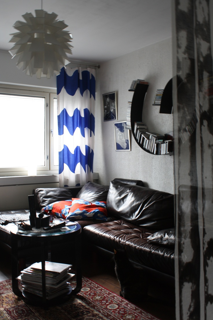 Curtains from fleamarket (Marimekko, Lokki), Sofa my parents old, pillows from Marimekko (mansikkavuoret), Kartell Bookworm, table gift from my parents (secondhand), lamp Norm 69, and Eero Aarnio (Double Bubble), Mat from IKEA.