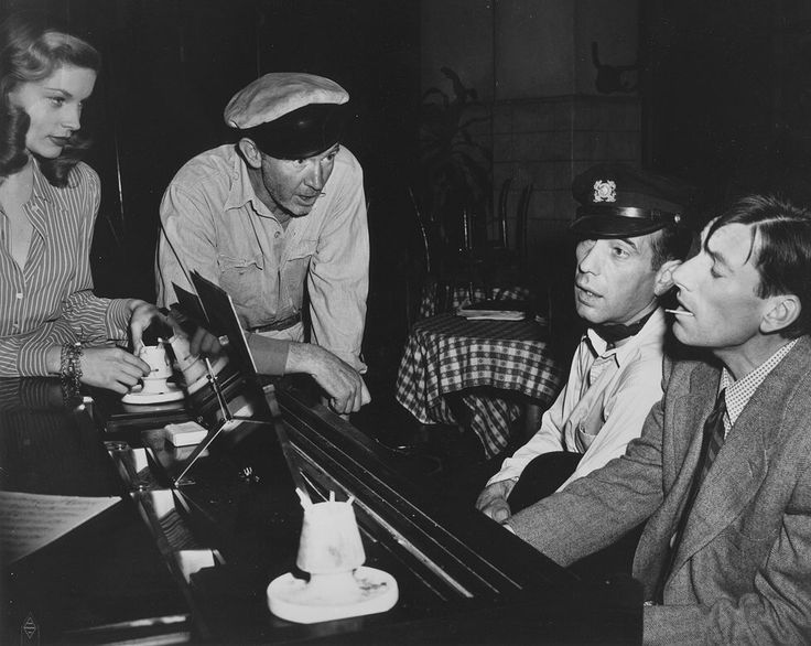 Hoagy Carmichael with Lauren Bacall, Walter Brennan and Humphrey Bogart on the set of To Have and Have Not, 1944, Howard Hawks.