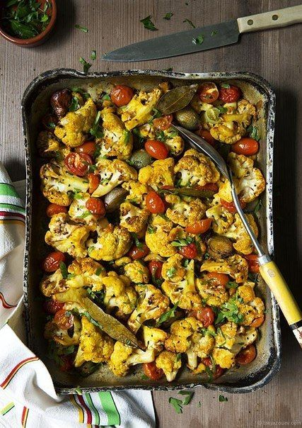 Baked cauliflower with tomatoes and beans!