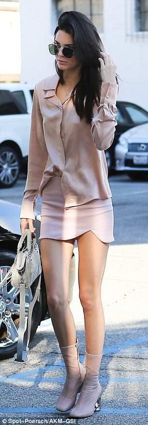 Pink lady! Jenner combed her fingers through her dark tresses while looking picture perfec...