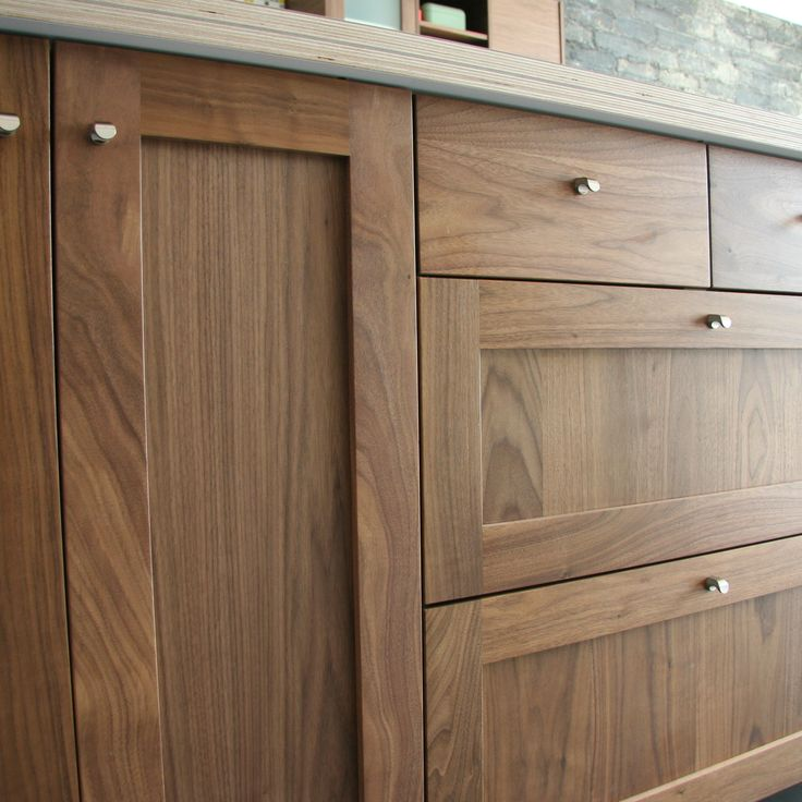 Detail shot of semihandmade walnut shaker ikea kitchen for Wood cabinets