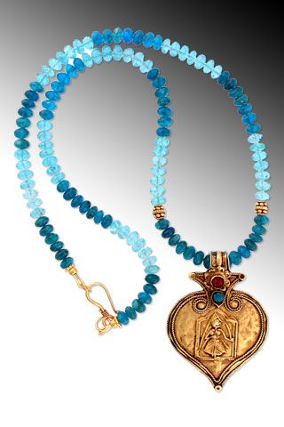 "Invulnerable: Antique 20K-22K indianplaque amulet pendant depicting the fierce goddess Kali -- with bezel-set fuchsia and teal blue stones -- on teal and aqua apatite rondelles with 18K accents. Pendant drop 1 3/4"". SOLD"