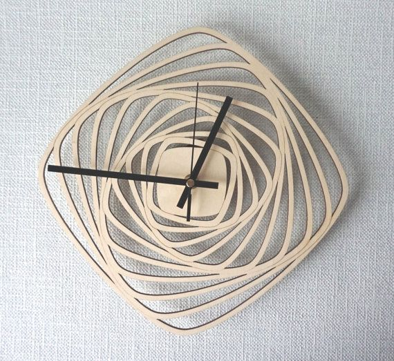 Unique and amazing looking wood wall clock. Made inspiring bu squares, dancing squares :) Made of natural birch plywood. Cut and engraved with laser,