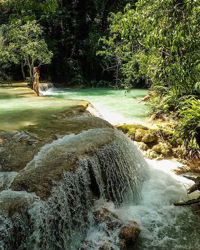 Kuang Si Falls, Laos Just one last pic because it's so beautiful! Can you see the girl? P.s. Beware of the nibbling fish! #travelintoliving @laospictures