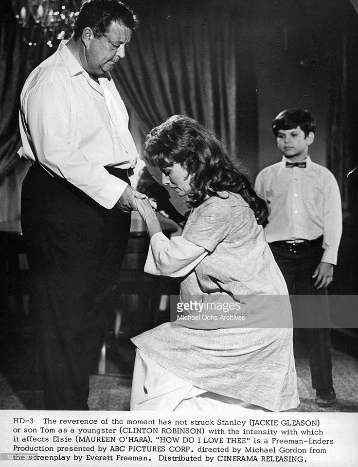 The reverence of the moment hasn't struck Jackie Gleason or son Clinton Robinson with the intensity with which it affects Maureen O'Hara in a scene from the film 'How Do I Love Thee?', 1970.