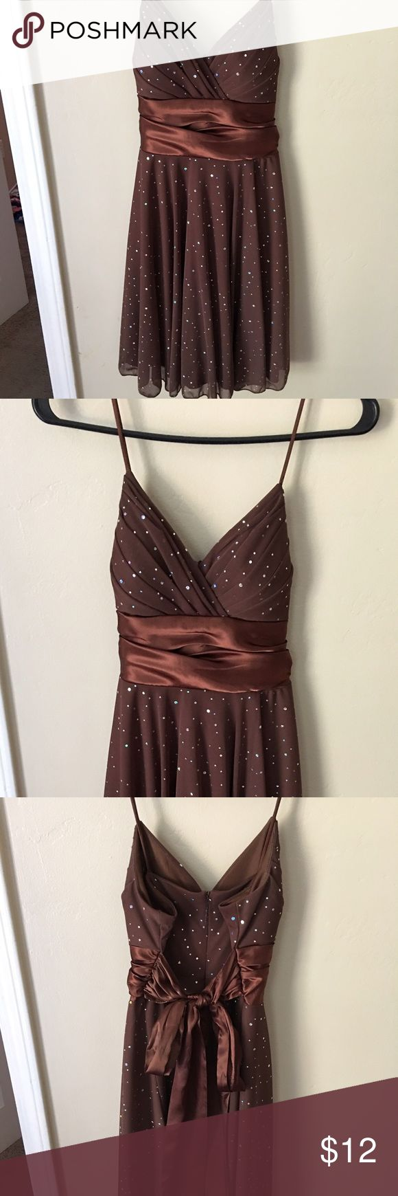 Sparkle brown mini dress Brown mini dress! Fitted chest tie to cinch in waist flowy bottom length above the knee mid thigh. Simple but cute. Give me your best offer! Dresses Midi