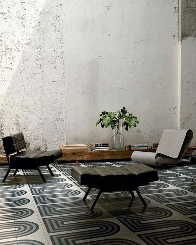 graphic tiled floor and concrete walls