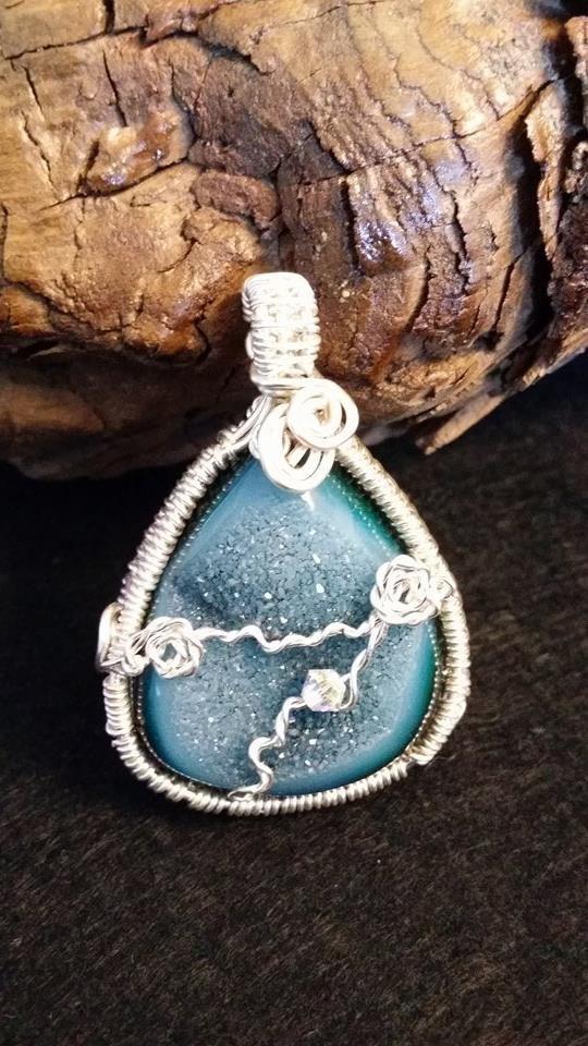 Anastasia our little gem...  Wire wrapped Druzy with small Swarovski crystal gem.  Booked piece