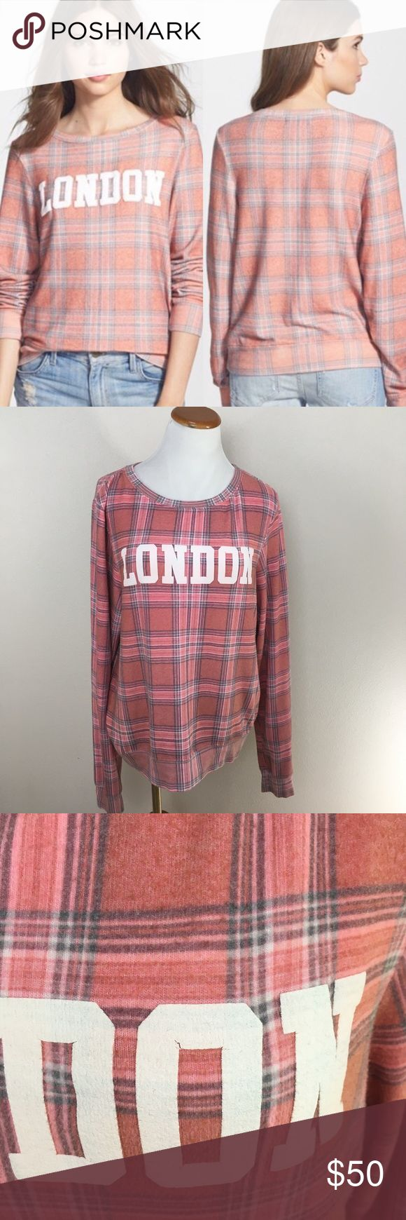 Wildfox Couture LONDON Pink Plaid Sweatshirt Large Wildfox Couture LONDON Pink Plaid Long Sleeve Sweatshirt Top Large. Good condition! It is a brushed fleece fabric so the fuzzy is manufactured that way. Normal wear and tear. Some cracking on letters due to normal wear and tear. Clean and comes from smoke free home. Questions welcomed! Wildfox Couture Tops Sweatshirts & Hoodies