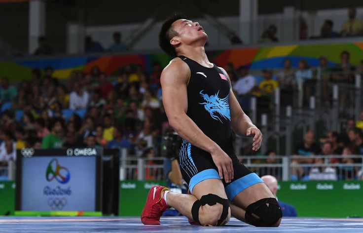 Disheartening defeat for China:    Bin Yang of China reacts after being defeated by Hyeonwoo Kim of Korea during the Men's 75 kg Repechage Greco-Roman Wrestling.      -  2016 Rio Olympics: Highs and lows from Day 9