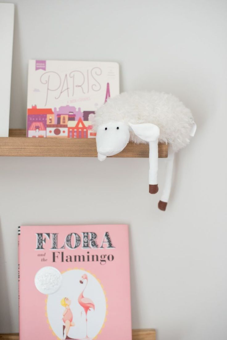 Pink mint and gray baby girl nursery project nursery - How Much Do You Love That Little Lazy Sheep Hanging On This Nursery Shelving