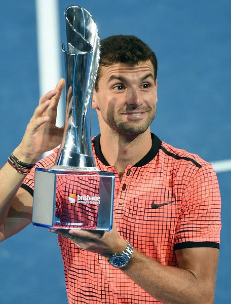 08 JAN 2017:  Grigor Dimitrov of Bulgaria holds the Roy Emerson trophy after winning  the Men's Final against Kei Nishikori of Japan during day eight of the Brisbane international at Pat Rafter Arena in Brisbane, Australia.
