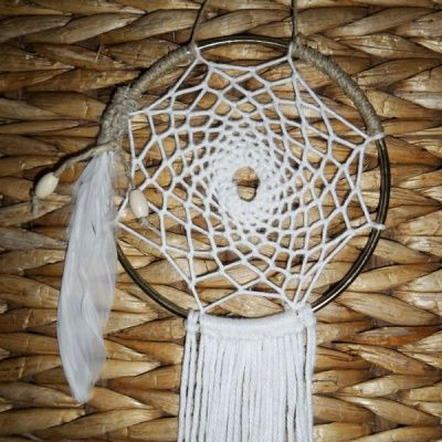 Vintage Dreams!! This delicate piece showcases its gorgeous gold hoop, with 100% wool weave and tail, the simplicity says it all single white feather wrapped in hemp with cream wooden beads. https://www.facebook.com/stardustdreamer https://instagram.com/stardustdreamer_/