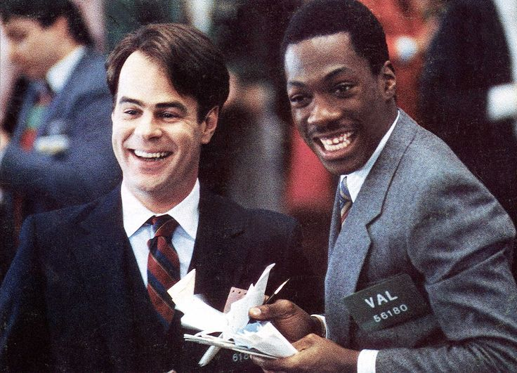 "Movies About Money ""Trading Places"" (1983) Eddie Murphy, Dan Aykroyd, Ralph Bellamy  Two millionaires, Mortimer (Don Ameche) and Randolph Duke (Ralph Bellamy) switch the positions of their employee and a con artist as part of a bet."