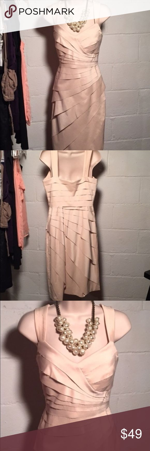 NWT Sangria champaign beige party dress Good nwt condition.  No stains, tears, or holes.  Comes in Garment bag  •I bundle & discount bundles •If an item is higher than you want to pay, message an offer or favorite & wait for price to drop weekly.  •My mannequin is Xsm so sometimes items appear loose or I clip back for actual look/fit •Usually ships within 24 hrs and latest 48 hours unless otherwise noted.  •Some of my items are various sizes because I sell for sister as well. #dress #wedding…