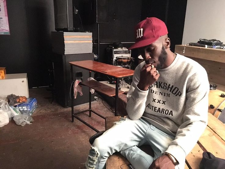 Kojey Radical wears the Workshop W Crewneck Sweatshirt and W Ebbets Field Baseball Cap