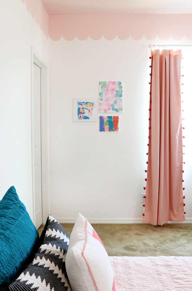 This modern girl's bedroom makeover combines a sweet pink DIY scalloped wall treatment with graphic black and white accents for a fun look.