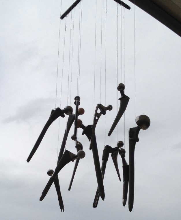 A wind chime installation made from 13 Total Hip Replacements (Mix