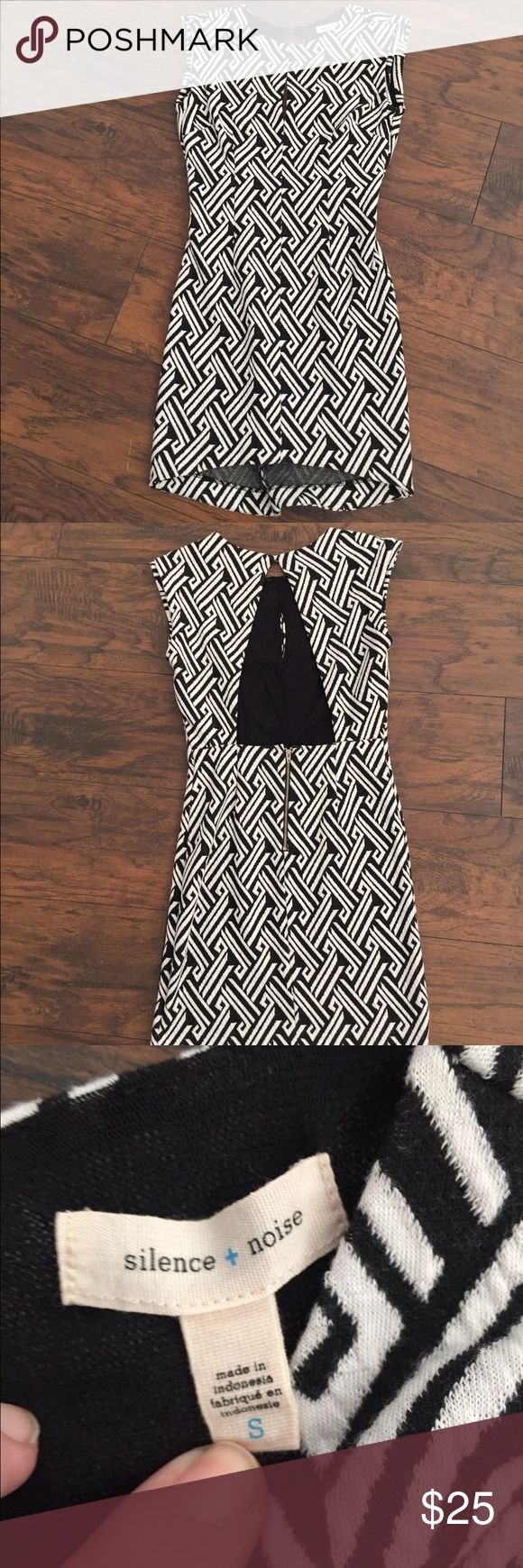 """Urban Outfitters Silence & Noise Dress This flattering dress is made of 16% Rayon, 1% Spandex, and 83% Rayon. The lining is 100% Nylon.  The quality of this dress is what you would expect from Anthropologie.  This dress is so cute and the black and white design is so unique. It has a keyhole in the front and the back is open. The dress is 33"""" long in the front and 35"""" long in the back so there is a slight hi/lol design to it. Urban Outfitters Dresses Midi"""