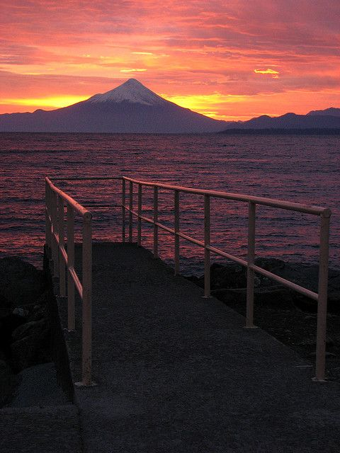 visitheworld:    Jetty and Volcan Osorno at dawn in Puerto Varas, Chile (by Sparky the Neon Cat).