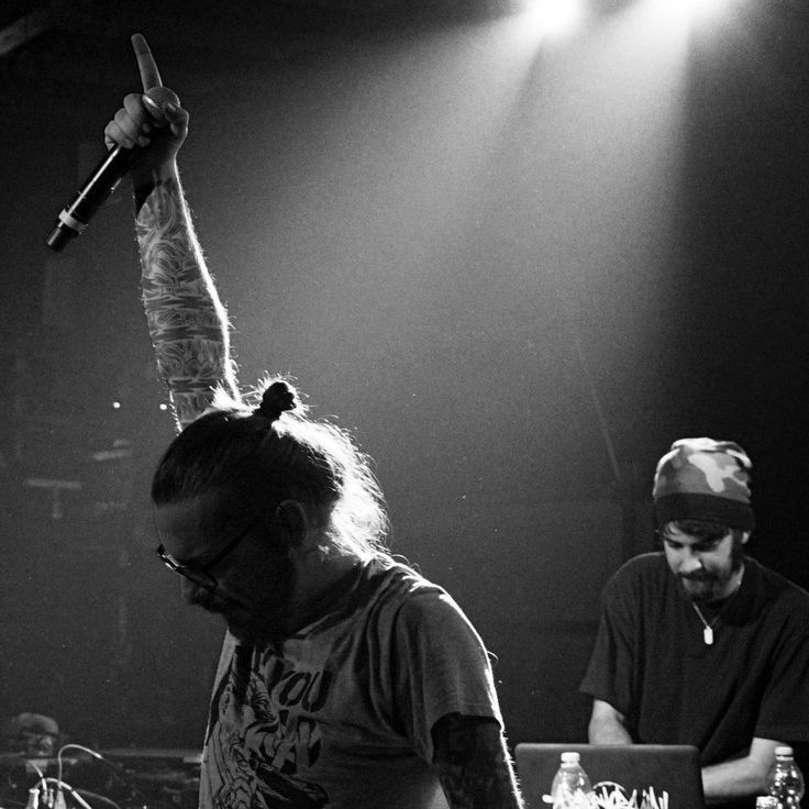 This is a picture of Kaos One performing with DJ Craim in Florence.