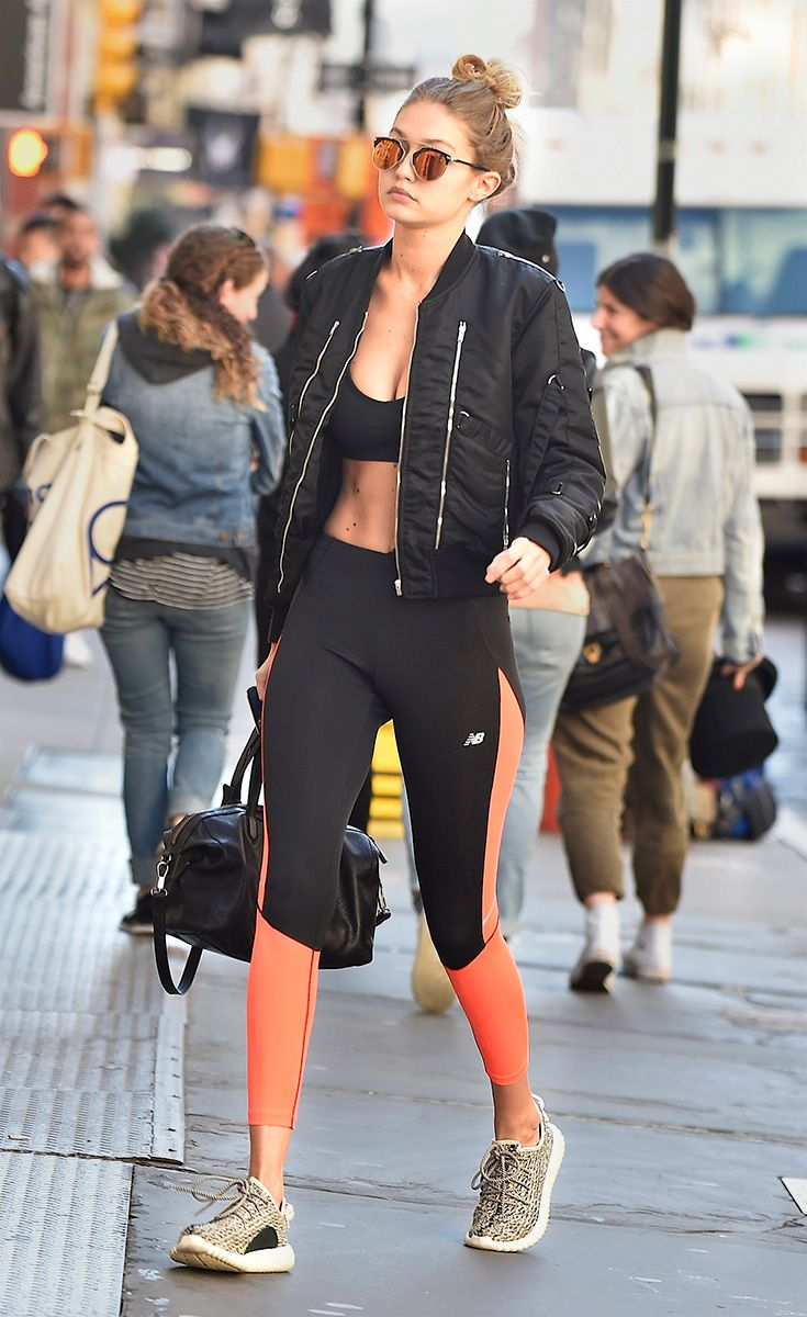 Gigi Hadid - With color-block leggings and a classic black sports bra, Gigi nails the gym-to-brunch athleisure look. A retro bomber on top has her ready to meet friends post-workout.