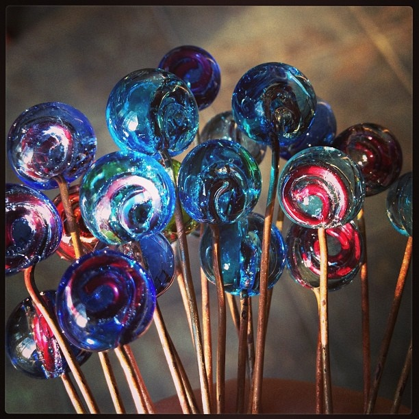 "New glass ""headpins"". Transparent encasing swirl of copper wire. #lampwork by GlassAddictions, via Flickr"
