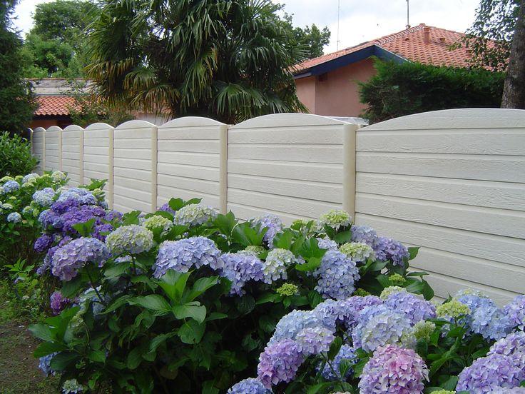 Pose de plaque de clôtures béton
