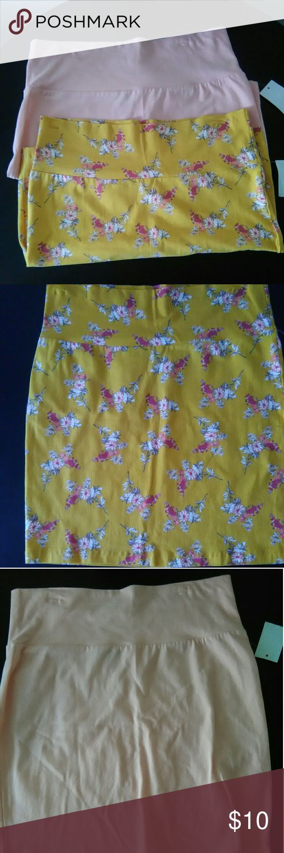 2 NWT Large Charlotte Russe Bodycon Skirt Bundle These New With Tags Bodycon skirts are the perfect addition to your wardrobe. These two skirts are have forgiving fabric blend of Cotton and Spandex so it is comfy for every body type. One skirt is is a mustard yellow with Floral accents in hues of red, peach, tan, olive, orange and white.  The second skirt is a Solid light  pink. Snatch this bundle up today. Item has been cross posted. Charlotte Russe Skirts Mini