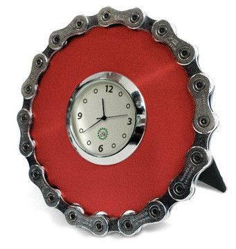 this fun little clock is perfect for a desk or bedside table made from recycled bicycle chain wrapped around anodized aluminum