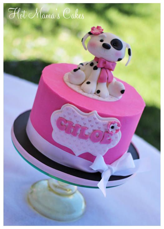 Puppy Cake for Chloe! - Cake is Ganached in White chocolate ganache tinted pink.. Puppy is sculpted out of wilton brand fondant :)
