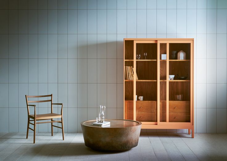 Joyce cabinet from design brand Pinch! Contemporary cabinet / sideboard with sliding glass doors. Interior lined in naturally-finished wood; lacquered exterior.