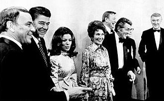 Frank Sinatra with California Governor Ronald Reagan, Vikki Carr, Nancy Reagan, Dean Martin, Jack Benny (obscured), John Wayne and Jimmy Stewart -- January 1971.