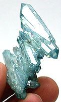 #AA-60 Nice little Aqua Aura Cluster with double-terminated crystals. 17 grams. $20 Aqua Aura is gold-treated quartz crystal. Created by a process which allows molecules of pure 24 karat gold to adhere to the natural electric charge which surrounds quartz crystals. The result is a beautiful blue irridescent color.