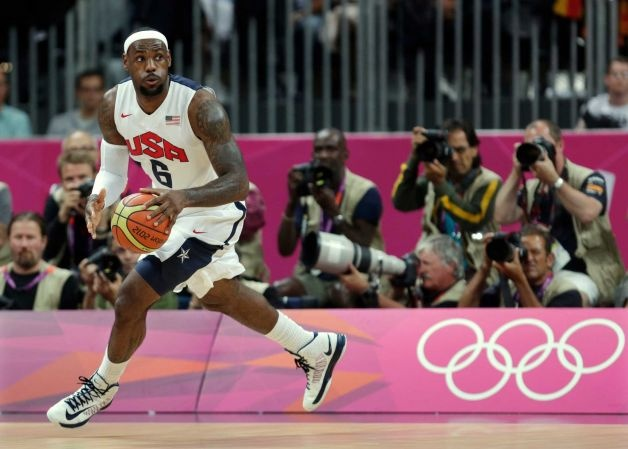 United States' Lebron James looks up the court during the first half of a preliminary men's basketball game against France at the 2012 Summer Olympics, Sunday, July 29, 2012, in London. (Charles Krupa / AP) - http://www.PaulFDavis.com/success-speaker (info@PaulFDavis.com)