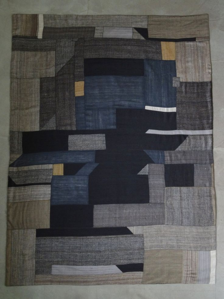patchwork throw / blanket / wallhanging  made of hand spun / hand woven khadi silk fabric (on both sides)  and with cotton molton filling  one of a kind
