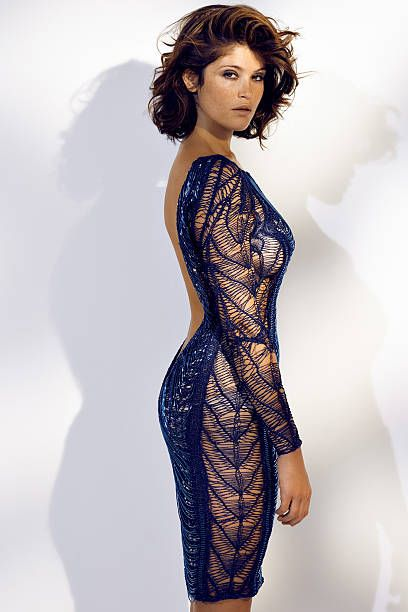 110258-011. Actress Gemma Arterton is photographed for Madame Figaro on June 19, 2014 in Paris, France. Dress (Julien MacDonald), earrings (Dior). Make-up by Sisley.