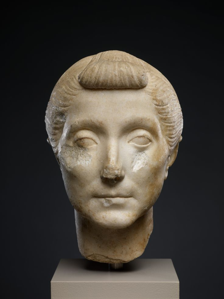 This portrait of an elderly Roman matron conveys an air of gravitas and dignity that befits the social standing of the subject. Like most portraits of Roman women, this one can be dated closely by the hairstyle, which combines a braided bun worn high on the head and the so-called nodus, a flat braid pulled back over the top of the head